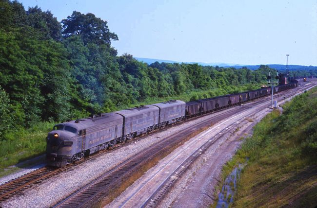 WM #60-#414 & #411 on coal train. (149 cars for B&O at Cherry Run) backing into East end of Cumberland Yard, Mexico, Md. 6/21/75.